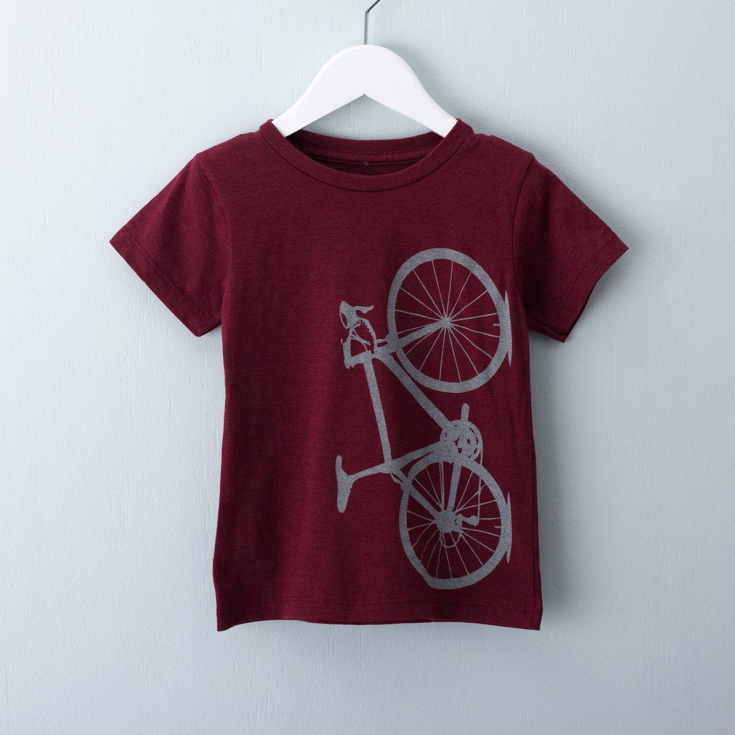 Cranberry toddler t-shirt screen printed with light grey bicycle