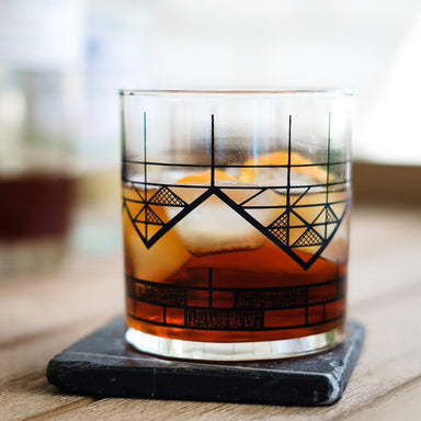 screen printed mountain glassware geometric design black print negori cocktail on black marble coaster