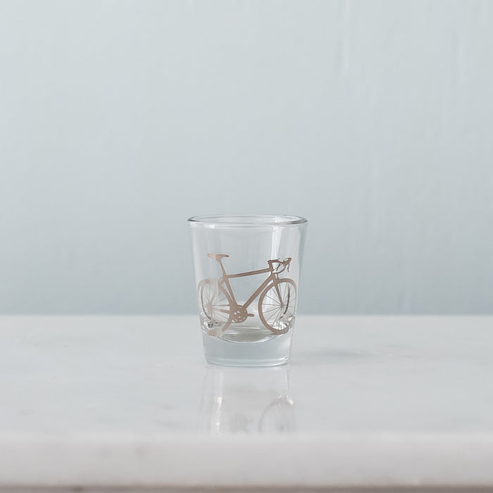 Shiny platinum silver bicycle screen printed on a shot glass