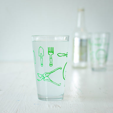 Green garden tools printed on a 16 oz. pint glass