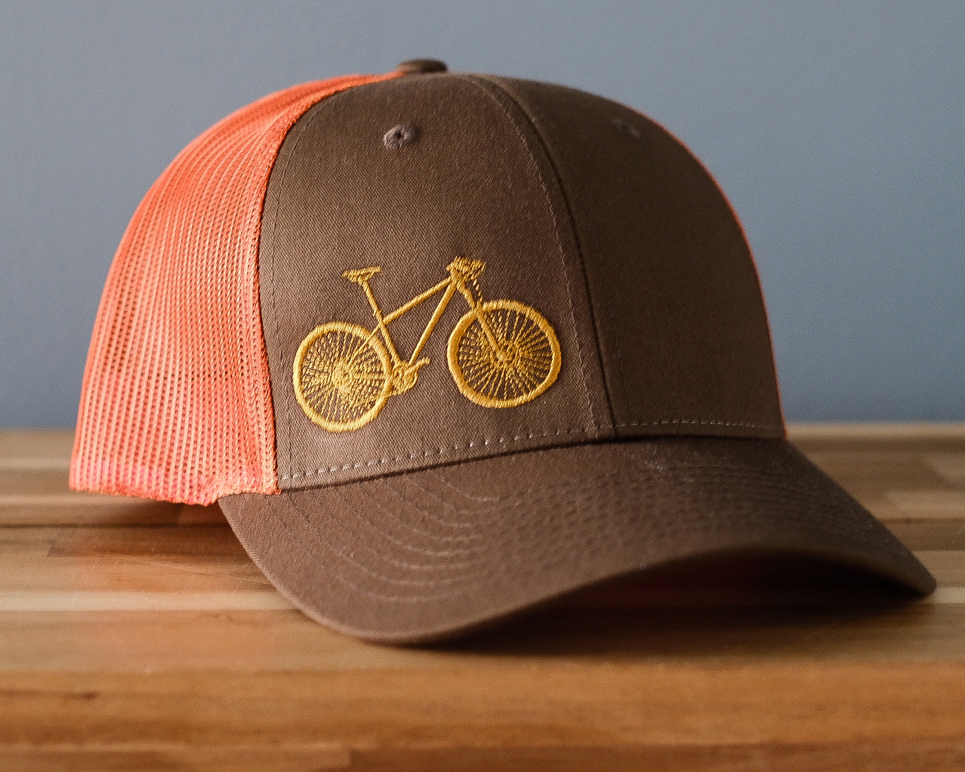Bicycle Embroidered Trucker Hat - Rust and Loden with Goldenrod bike