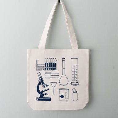 Navy science lab tools including pipettes, a microscope and flask screen printed on a 100% cotton canvas tote