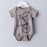Titanium grey infant one piece bodysuit screen printed with a warm grey road bicycle