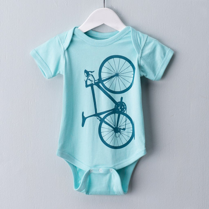 Light blue infant one piece bodysuit screen printed with a teal road bicycle