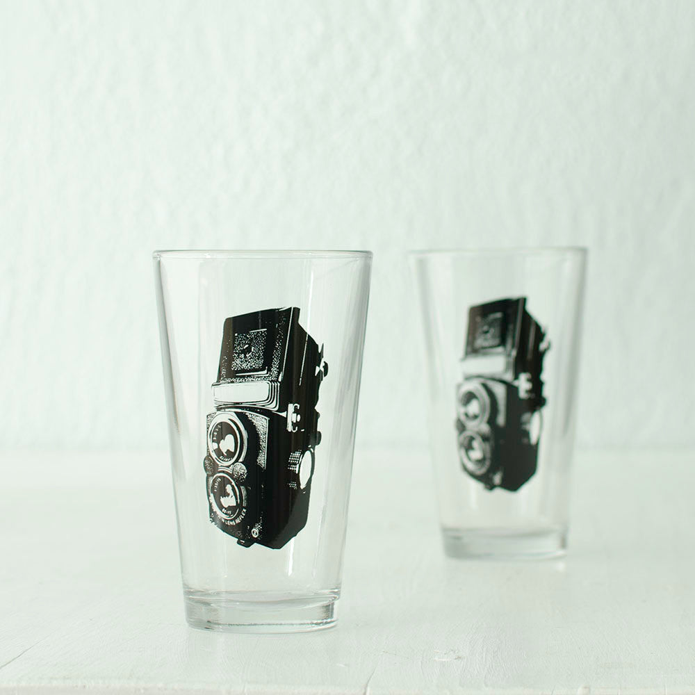 Twin-lens reflex camera screen printed on a 16 oz. pint glass in black