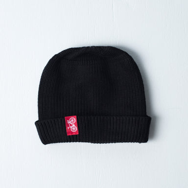 Black dock beanie with red sewn on bicycle tag