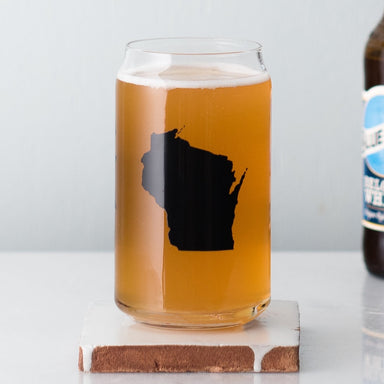 Wisconsin beer can glass sitting next to a Blue Moon bottle