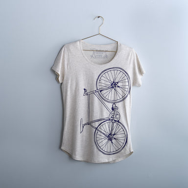 women's bike bicycle screen printed graphic tee oatmeal t-shirt with purple fixed gear bike print on gold hanger