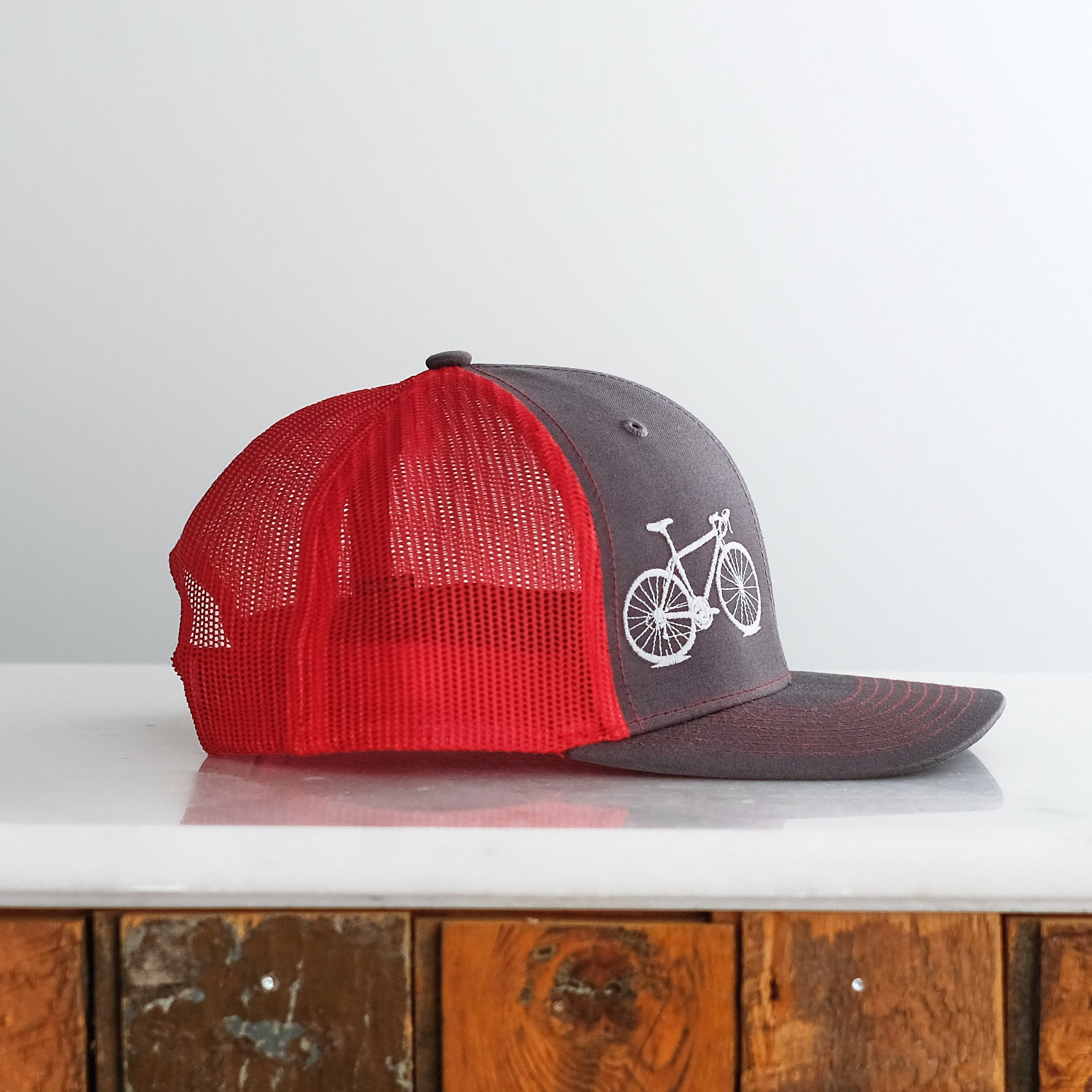 Bicycle Trucker Cap, matte gray on charcoal/red hat
