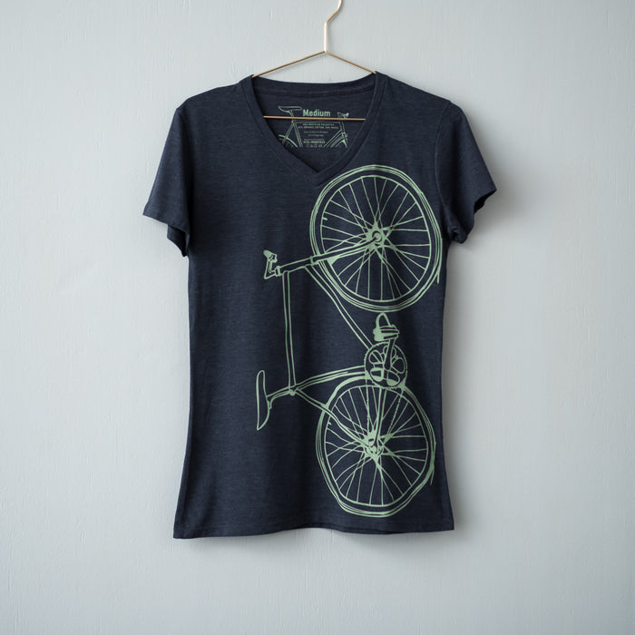 Navy all made v-neck t-shirt screen printed with a teal bicycle displayed on a gold hanger