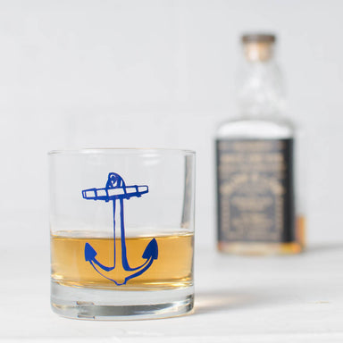 Navy blue anchor screen printed on a rocks glass and filled with liquor