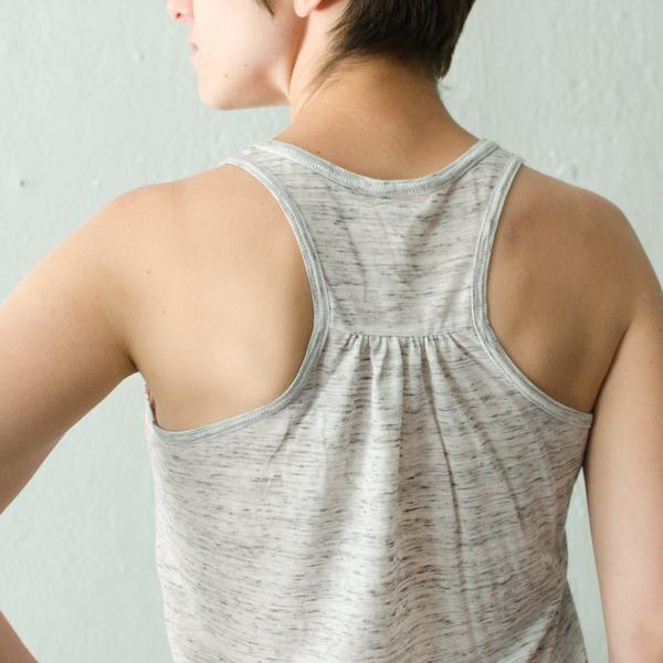 Grey and white marble racerback tank top on brunette model