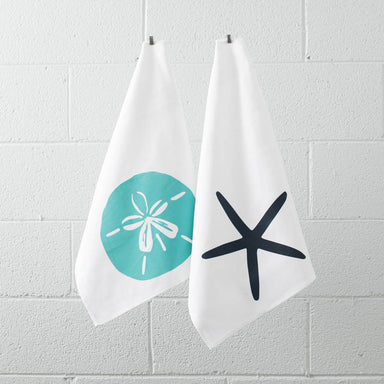 Turquoise sand dollar and navy starfish tea towels hanging
