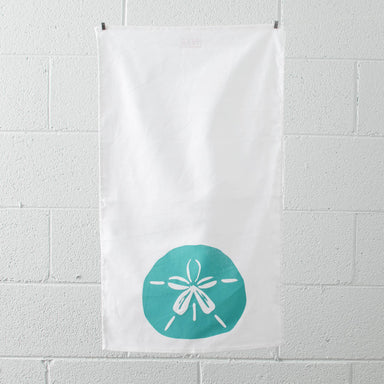 Turquoise sand dollar tea towel hanging