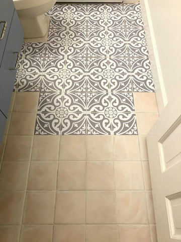 Applying tiles stickers on bathroom floor