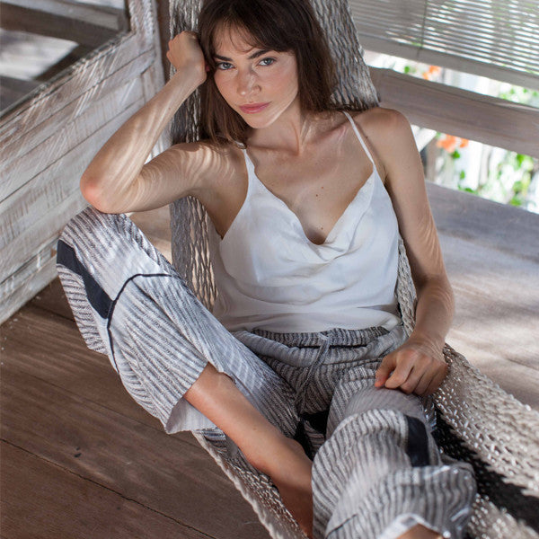 Tank in white Palazzo pants in Graphite Blue featherbone print model in hammock
