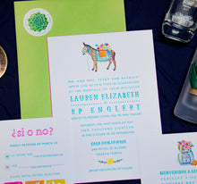 Load image into Gallery viewer, Mexican letterpress wedding invitation with watercolor illustrations of papel picado, burro with flowers, and a tequila bottle with a bouquet, arranged in a flat lay. Features bright colors and playful text and a lime green envelope