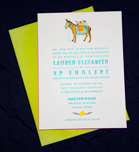 Mexican letterpress wedding invitation with watercolor illustrations of a burro with flowers and a floral garland. Lime green envelope.
