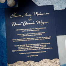 "Load image into Gallery viewer, A navy blue invitation with gold foil printing depicting text and ocean waves. The waves are in a stylized japanese wave pattern called ""seigaiha"""