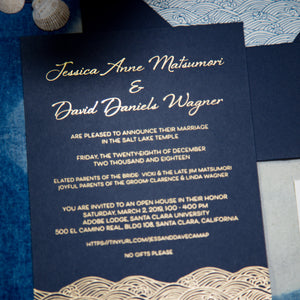 "A navy blue invitation with gold foil printing depicting text and ocean waves. The waves are in a stylized japanese wave pattern called ""seigaiha"""