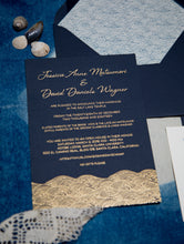 "Load image into Gallery viewer, A navy blue invitation with gold foil printing depicting text and ocean waves. Envelope liner with the same pattern in blue on ivory. The waves are in a stylized japanese wave pattern called ""seigaiha"""