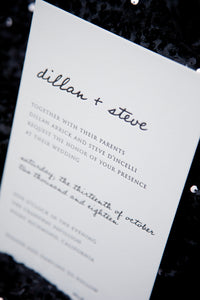 Minimalist letterpress wedding invitation in black and white. This image features the texture of letterpress. The names are in a modern handwriting font, paired with a block serif typeface for the information.