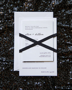 Modrn letterpress wedding invitation for a chic, urban black tie wedding. Features hand lettering and a block serif typeface, and tied a black silk ribbon in an X pattern.