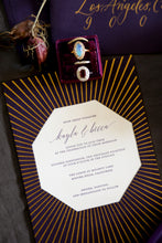 Load image into Gallery viewer, A violet wedding invitation with gold foil sunburst pattern and octagon shape, with elegant calligraphy and small caps for the text