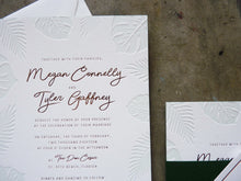 Load image into Gallery viewer, Letterpress wedding invitation with Palm and Monstera leaves and gold foil detail shot with custom monogram