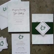 Load image into Gallery viewer, Letterpress wedding invitation with Palm and Monstera leaves, gold foil, and elegant belly band