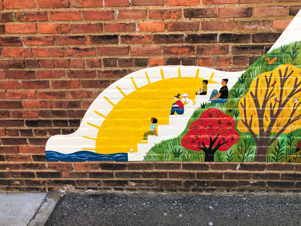 Section of mural with trees and people sitting on the Solstice Steps