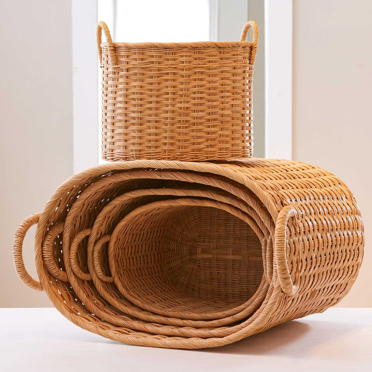 Oval rattan storage baskets with lids and handles. Perfect baskets for clothes, bathroom storage baskets, or baskets for shelves. XL, L, M, S, XS.