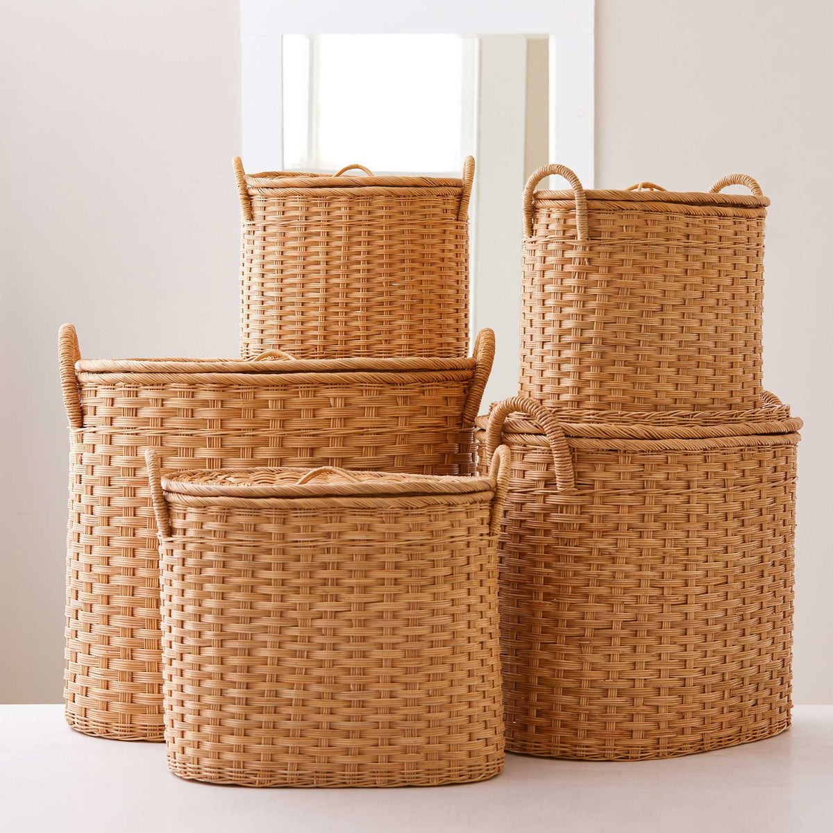 Oval rattan storage baskets. Unique storage baskets with lids and handles. 5 sizes from large storage baskets to small. Perfect baskets for shelves.