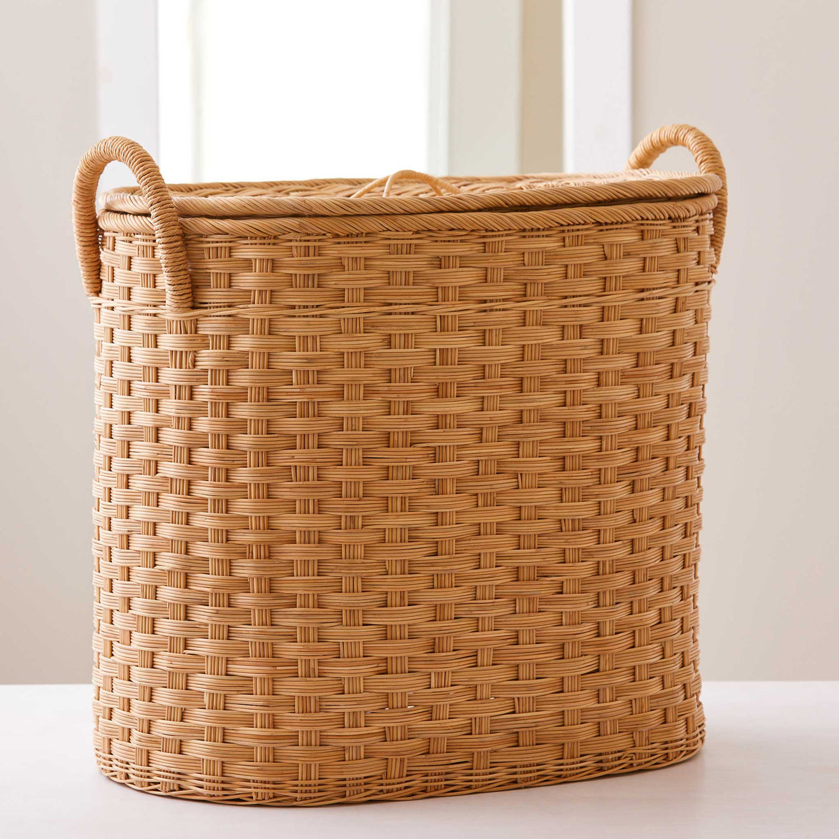 Oval rattan storage basket. Unique storage baskets with lids & handles. 5 sizes. Extra Large basket shown. Great basket for storage. XL, L, M, S, XS.