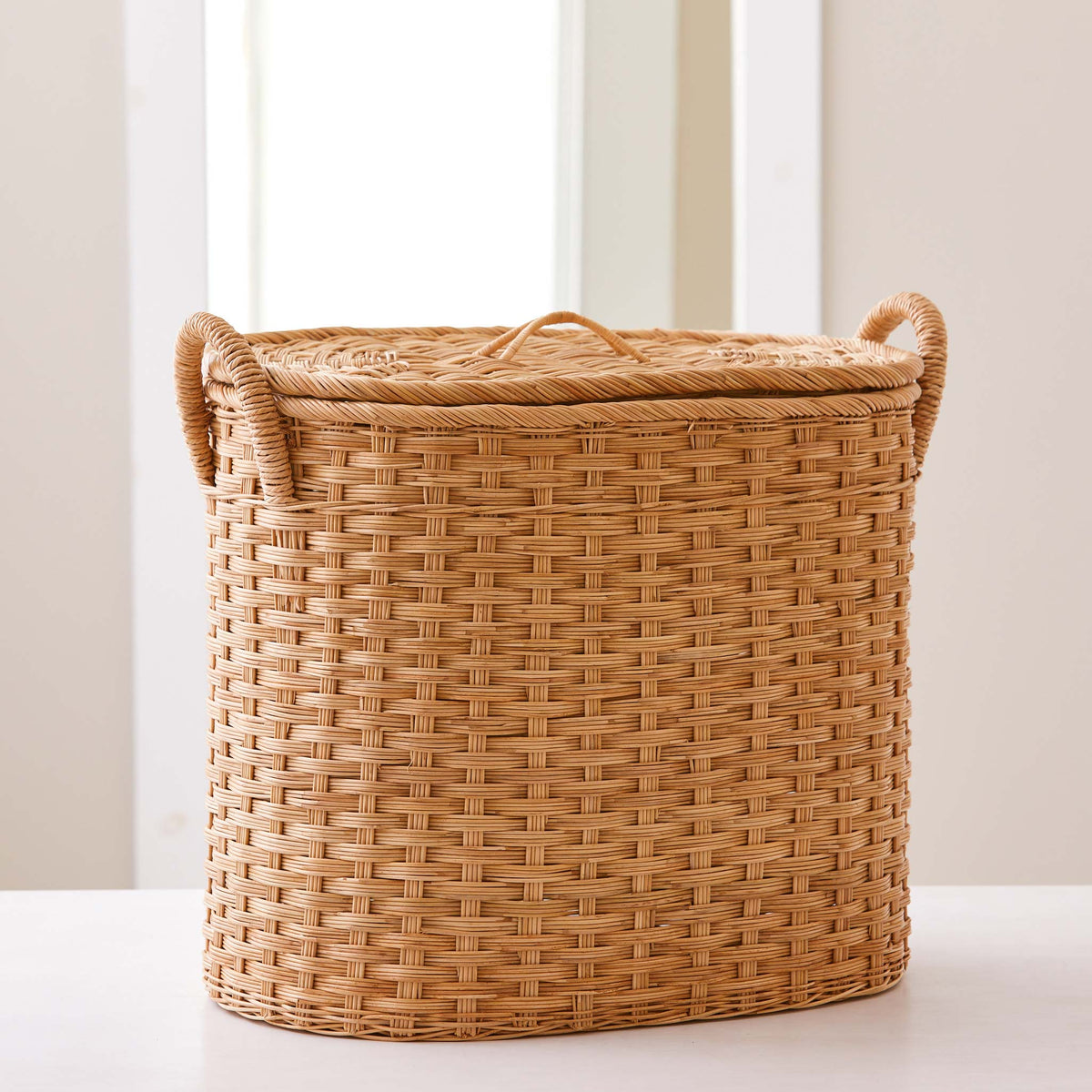 Oval rattan storage basket. Unique storage baskets with lids and handles. 5 sizes. Large basket shown. Great basket for storage. XL, L, M, S, XS.