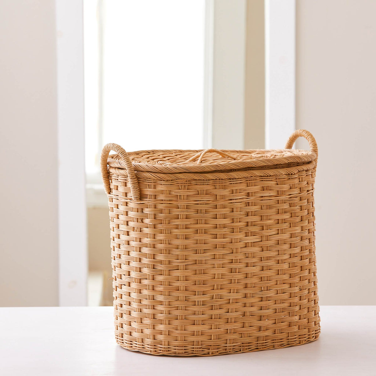 Oval rattan storage basket. Unique storage baskets with lids and handles. 5 sizes. Medium basket shown. Great basket for storage. XL, L, M, S, XS.