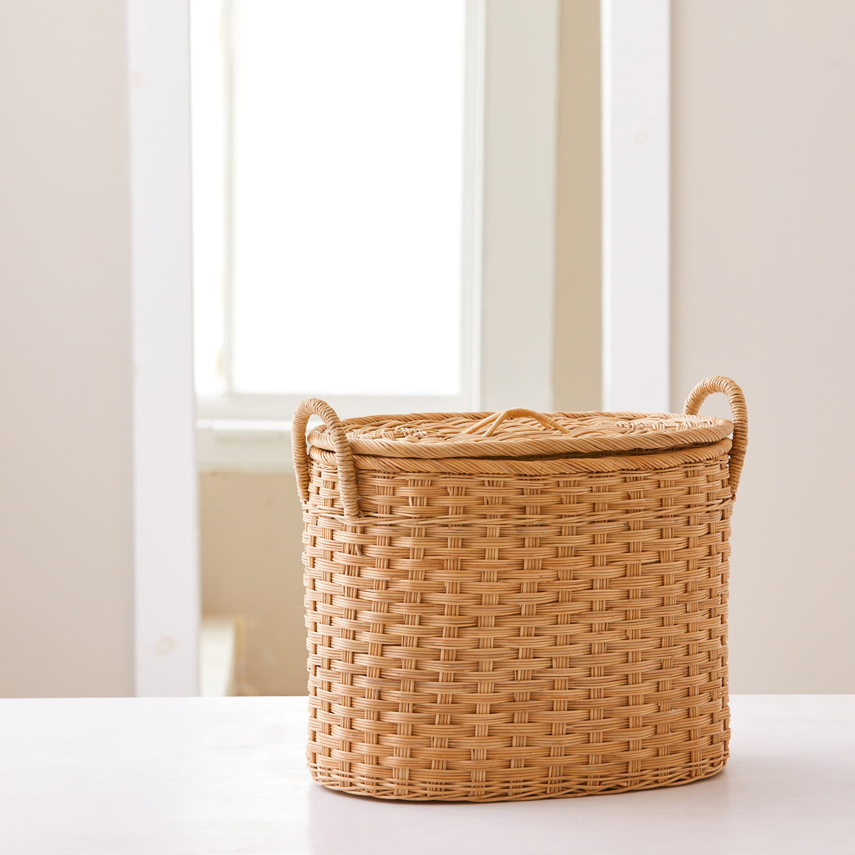 Oval rattan storage basket. Unique storage baskets with lids and handles. 5 sizes. Small basket shown. Great basket for storage. XL, L, M, S, XS.