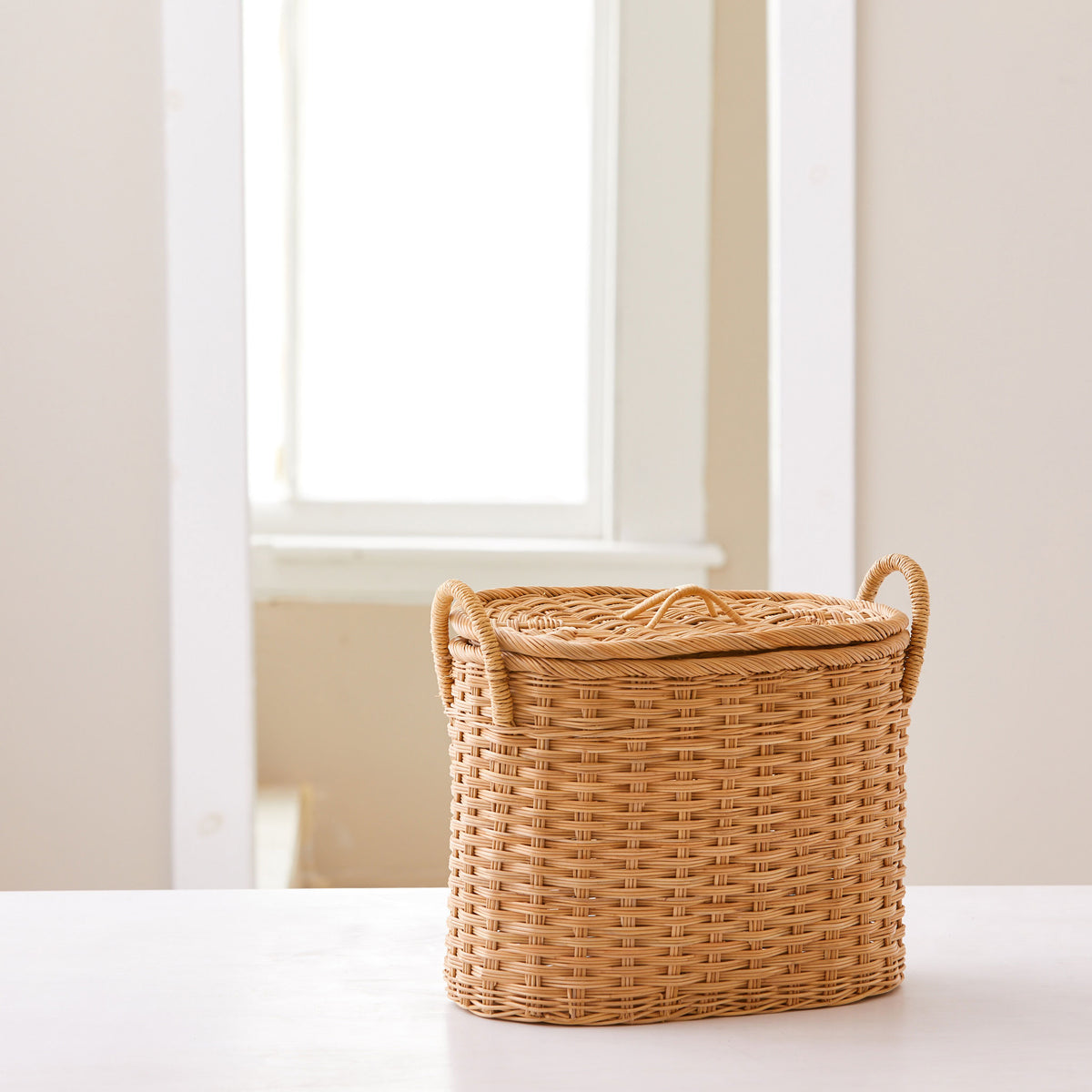 Oval rattan storage basket. Unique storage baskets with lids and handles. 5 sizes. Extra Small basket shown. Great basket for storage. XL, L, M, S, XS.