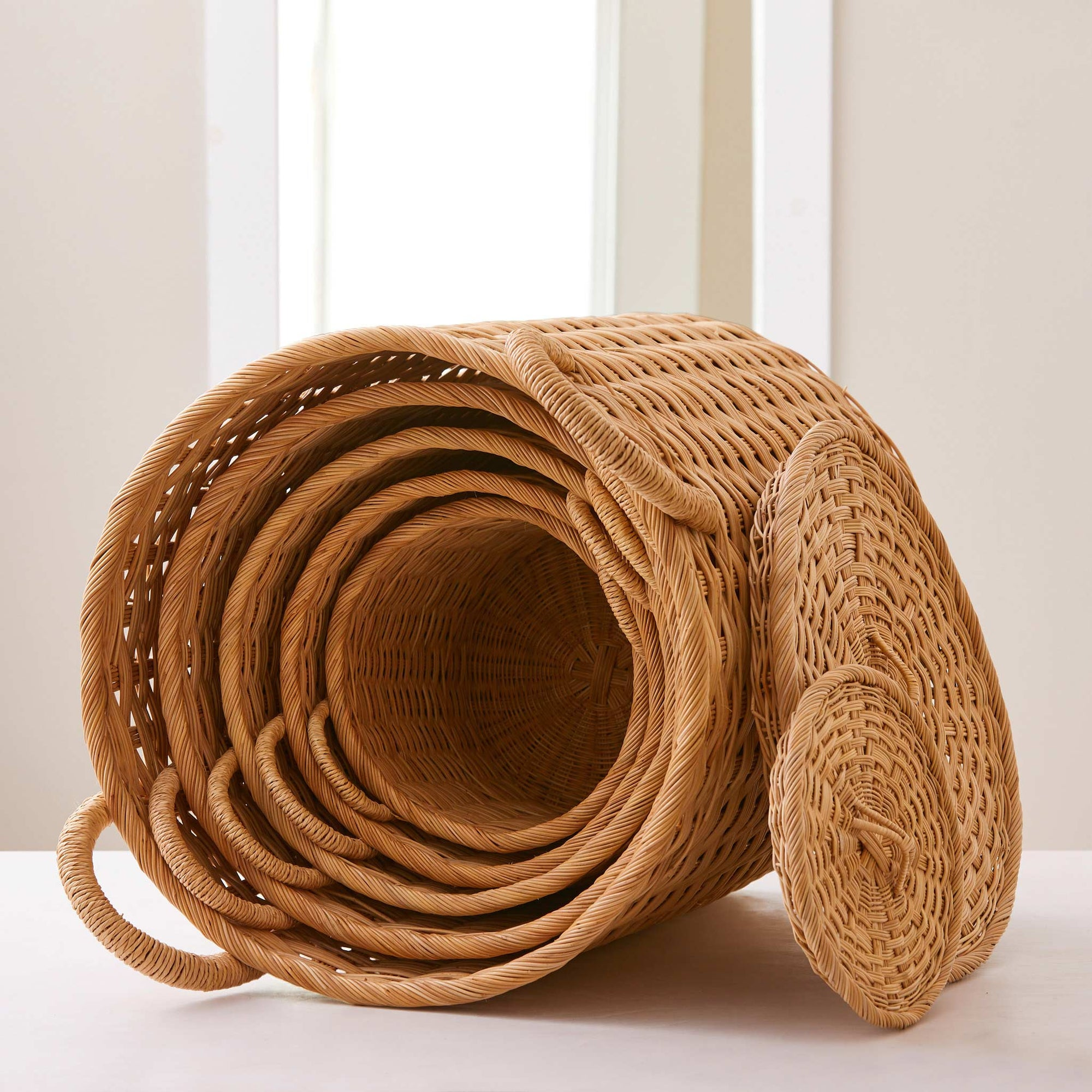 Round rattan storage baskets. Unique storage baskets with lids and handles. 5 sizes from large storage baskets to small. Perfect baskets for shelves.