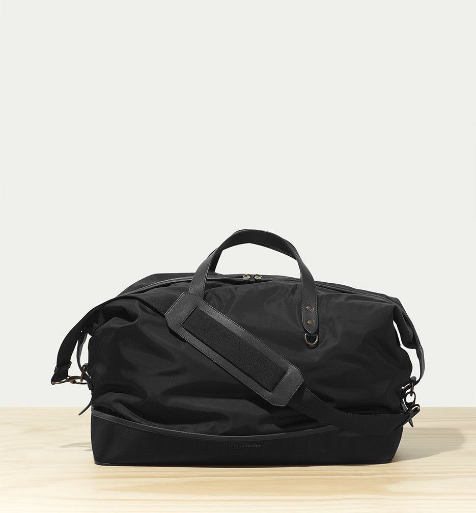 nylon duffel bag with leather trim