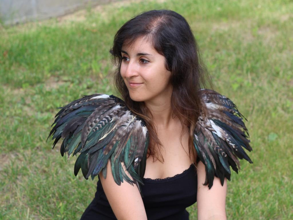 READY FOR HALLOWEEN . Shoulder Wings feathers: white and black.