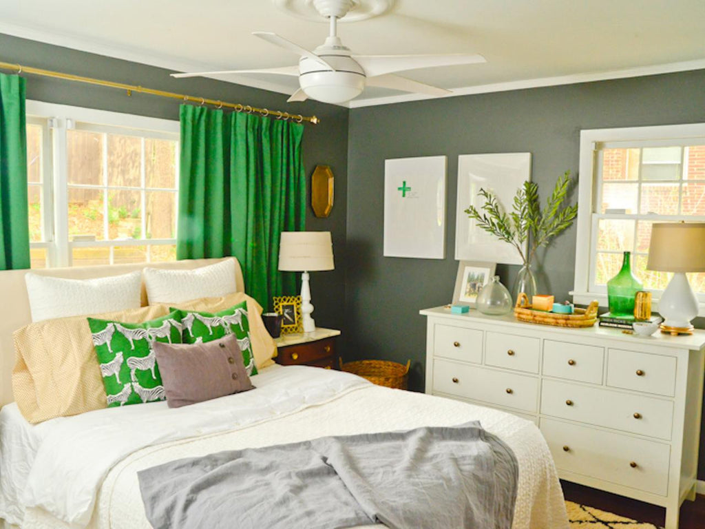 Green accents add a fresh pop of color to a neutral bedroom.