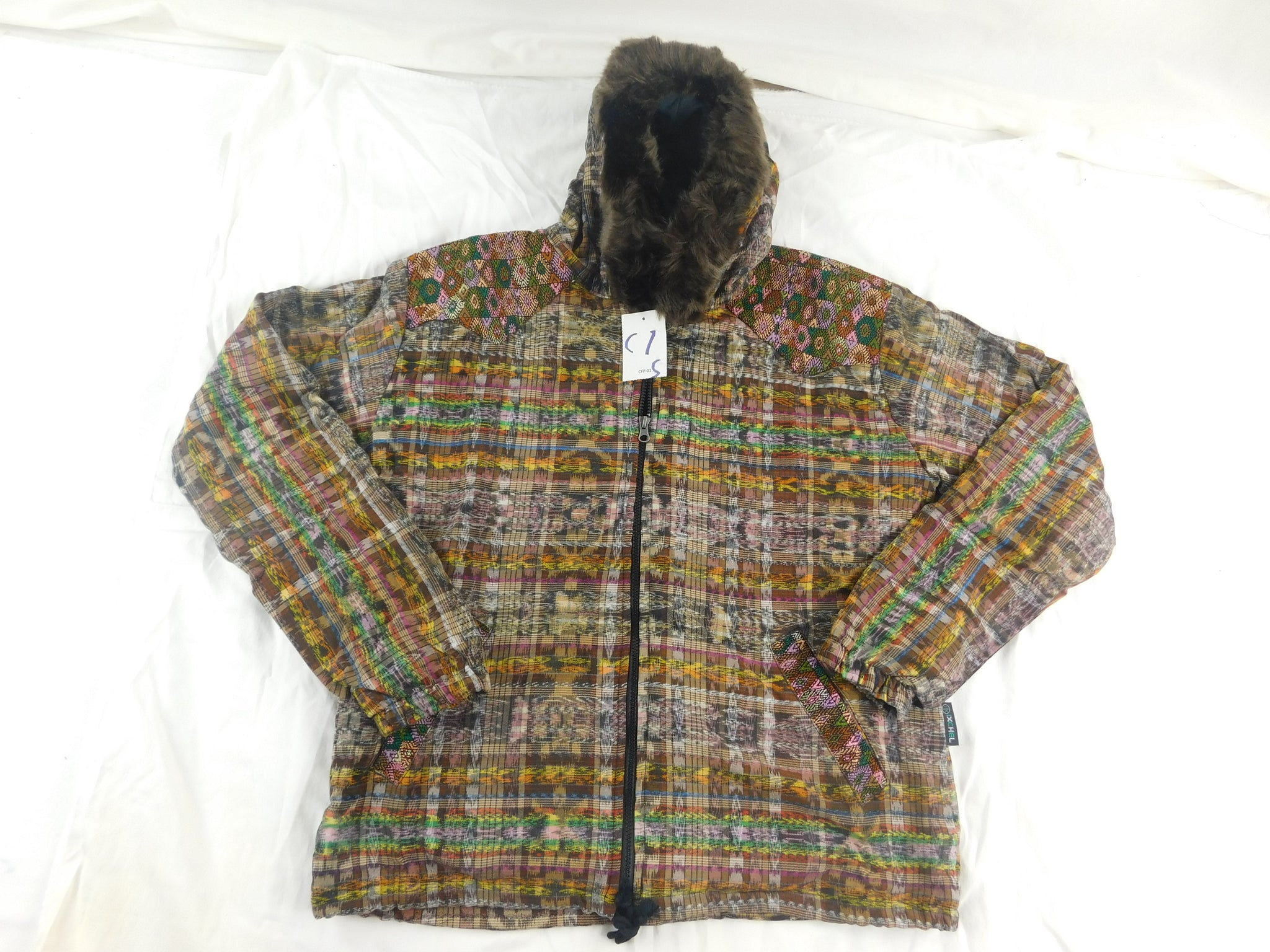 Hooded jacket in native Ikat and brocade fleece lined with fur hood