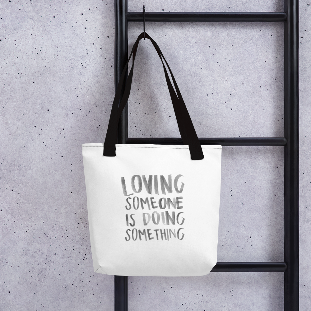'Loving Someone Is Doing Something' Tote bag