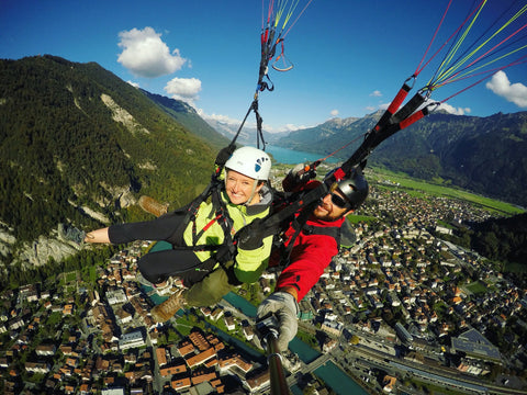Lauren and Henry Costa paragliding in Switzerland