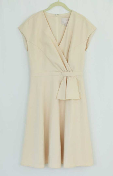 Cream dress with waist detail