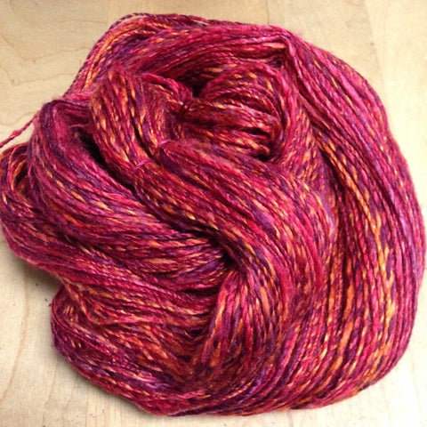 finished skein, piled on a wooden surface