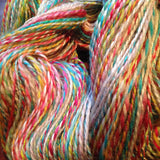 closeup of plied handspun yarn in rainbow shades and pale grey
