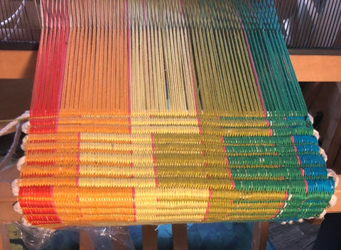 close-up image of the same rainbow rep-weave pattern in progress