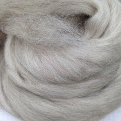 soft oatmeal colored roving twisted into a neat pile